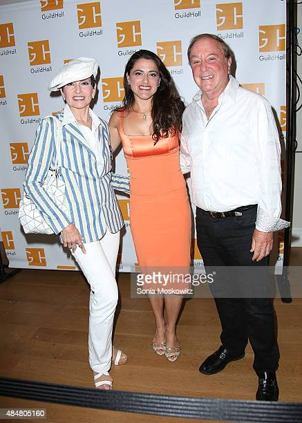 """Arlene Lazare and Alan Lazare and their daughter attend """"Celebrity Autobiography"""" at Guild Hall on August 21, 2015 in East Hampton, New York."""