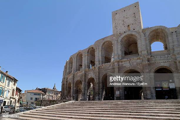 arles amphitheatre against clear sky - amphitheatre stock photos and pictures
