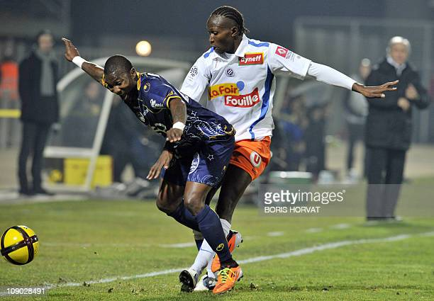ArlesAvignon's forward Franck Dja Djedje fights for the ball with Montpellier's defender Mapou Yangambiwa during their French L1 football match...