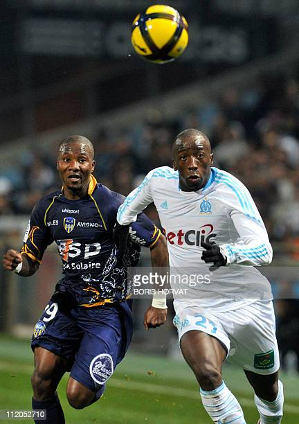 ArlesAvignon's forward Franck Dja Djedje fights for the ball with Olympique Marseille's Senegalese defender Souleymane Diawara during the French L1...