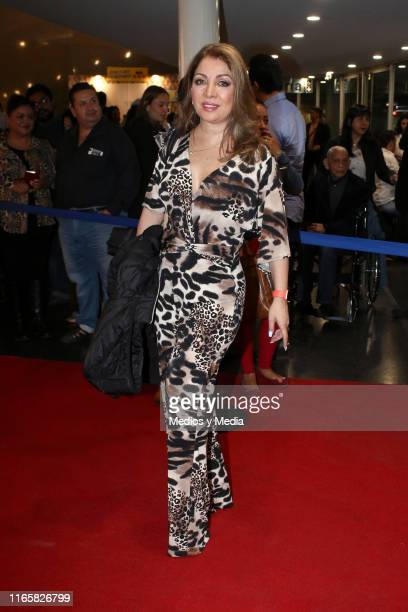 Arlette Pacheco poses for photos on the red carpet during a new premiere of the play 'Suertudotas' after changing the venue to Teatro Insurgentes on...