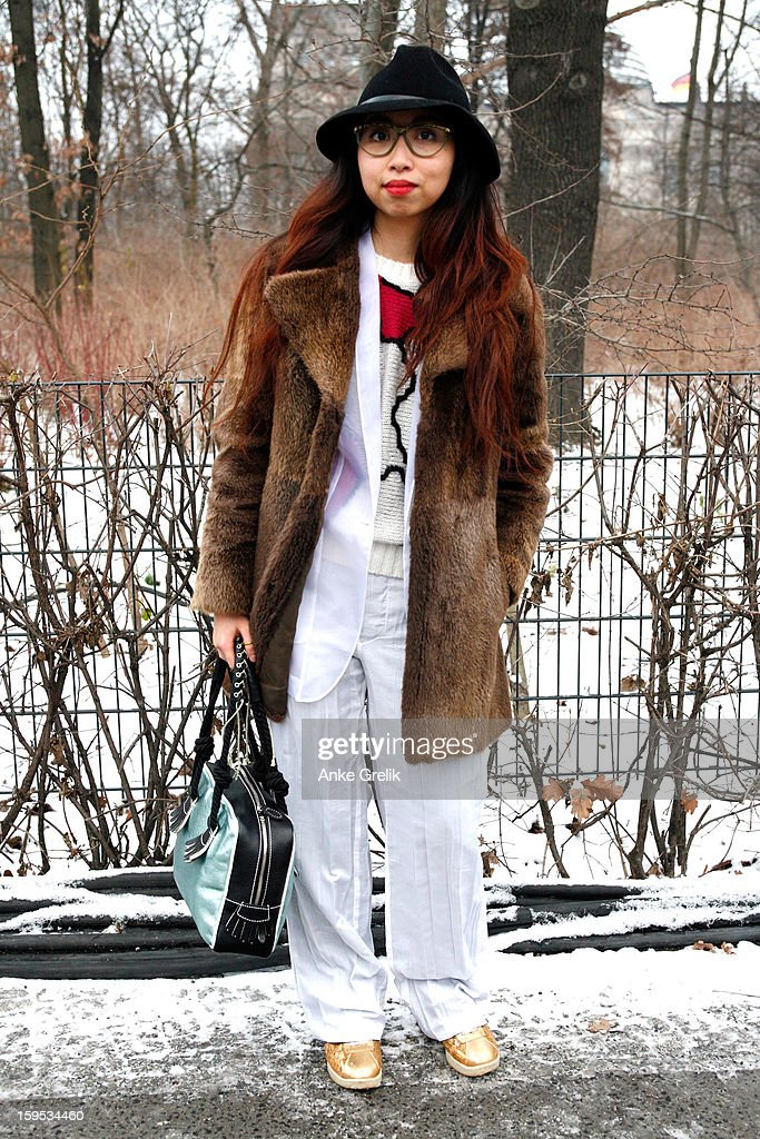 Arlette wearing D&G coat, Burberry hat, trouser Miyake attends Mercedes-Benz Fashion Week Autumn/Winter 2013/14 at venue on January 15, 2013 in Berlin, Germany.