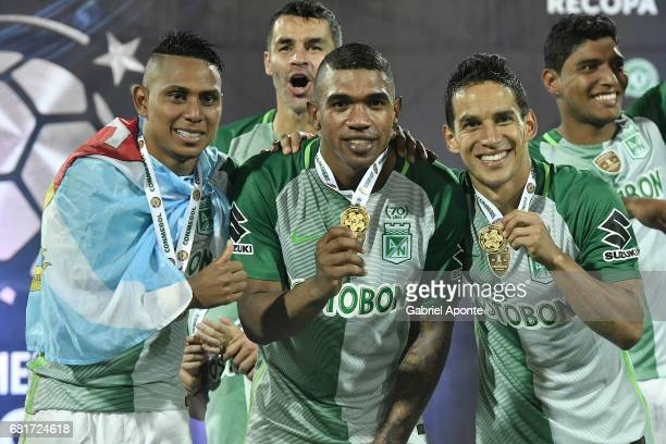 Arley Rodriguez Elkin Blanco and Diego Arias of Nacional celebrate with their medals as champions of the CONMEBOL Recopa Sudamericana 2017 after a...