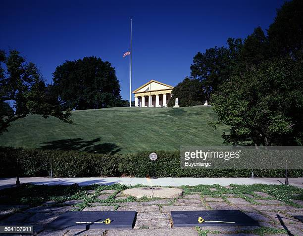 Arlington House Robert E Lee mansion looming above the Kennedy Family gravesite and eternal flame at Arlington National Cemetery Arlington Virginia