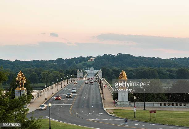 Arlington Memorial bridge leading across Potomac river to Arlington Cemetery in Virginia at sunset, Washington DC, USA