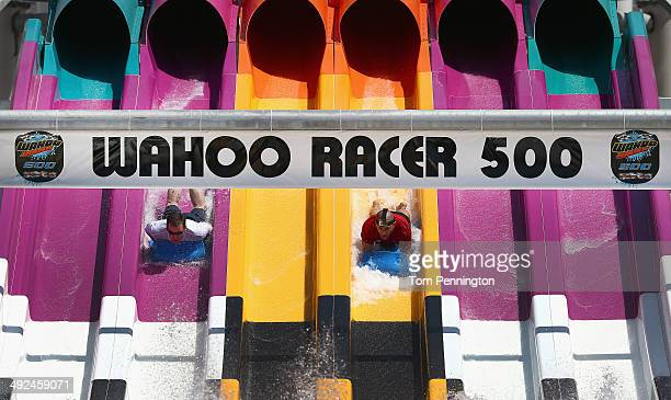 Arlington Police Chief Will Johnson races against IndyCar driver and defending Indy 500 champion Tony Kanaan on the new Wahoo Racer water slide at...