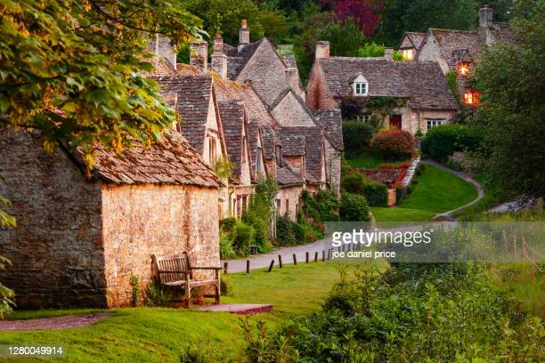 arlington row, bibury, cotswolds, gloucestershire, england - village stock pictures, royalty-free photos & images