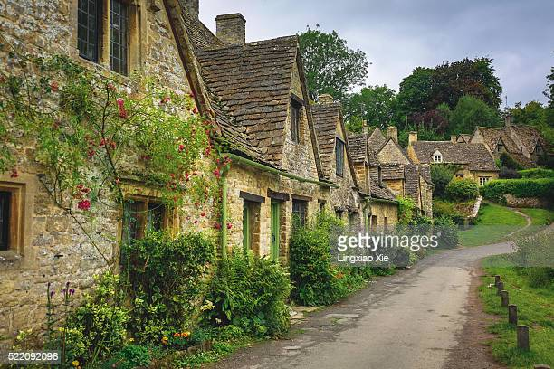 Arlington Row in the Cotswolds village of Bibury, Gloucestershire, England, UK