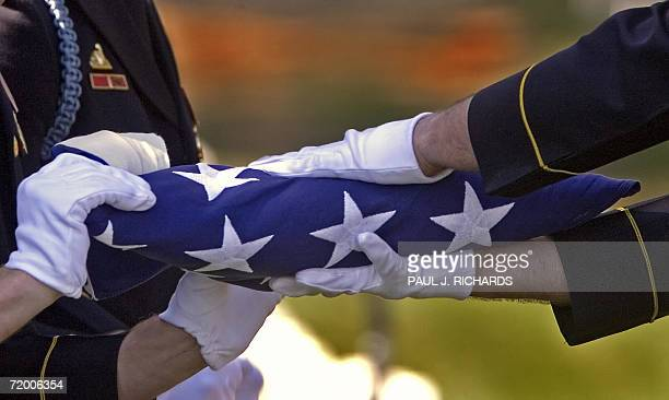 US Army Honor Guard fold the flag that covered the casket of US Army Pvt Francis Lupo of the 18th Infantry 1st Division during military honor burial...