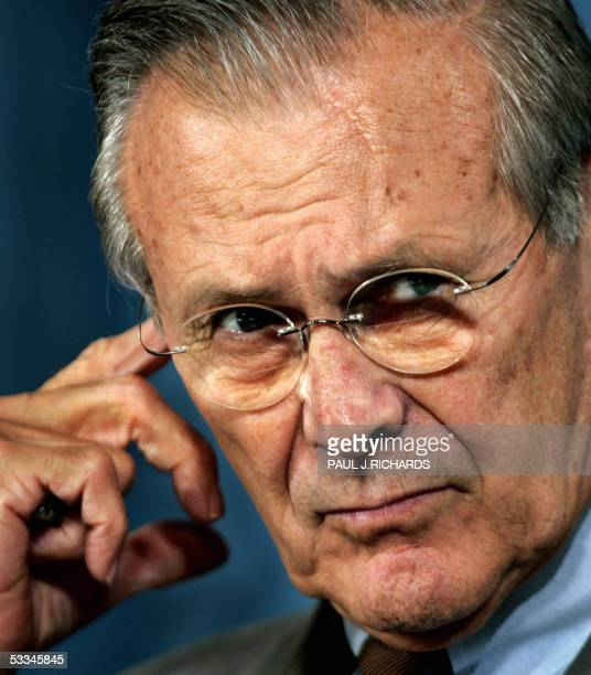 US Secretary of Defense Donald Rumsfeld listens to a quesion during a briefing with Chairman of the Joint Chiefs of Staff Air Force Gen Richard Myers...