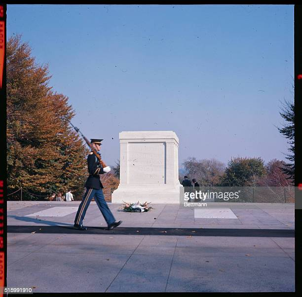 Photo of the Tomb of the Unknown Soldier in Arlington A soldier on vigil marches in front of the tomb