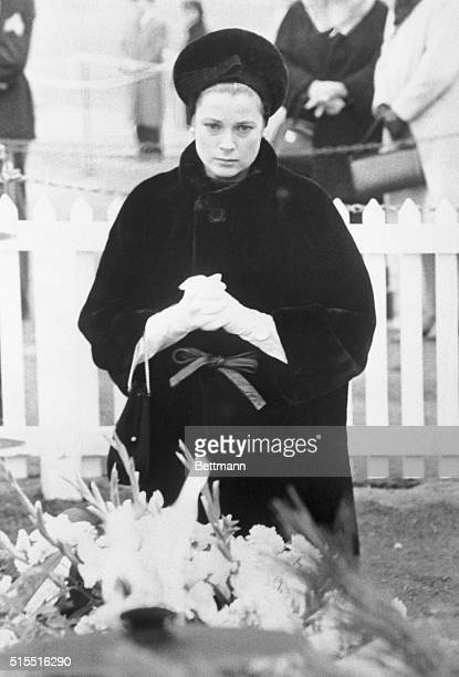 Princess Grace of Monaco kneels at the grace of the late President John F Kennedy during a visit to the National Cemetery here today The princess...
