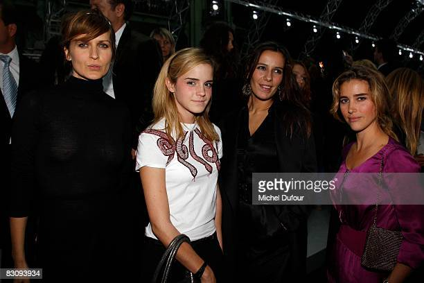 Arly Jover Emma Watson Zoe Felix and Vahina Giocante attend the Yves Saint Laurent fashion show during Paris Fashion Week at the Grand Palais n...