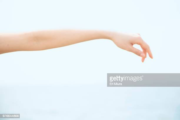 arm and horizontal line - reaching stock pictures, royalty-free photos & images
