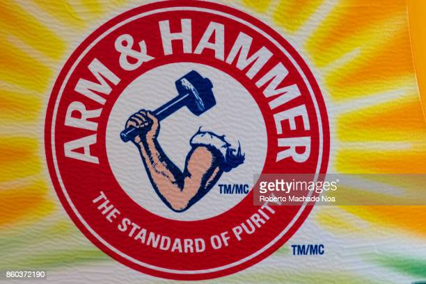 Arm Hammer sign or logo The brand name belongs to the Church Dwight company which manufactures household products The logo depicts a muscular arm...