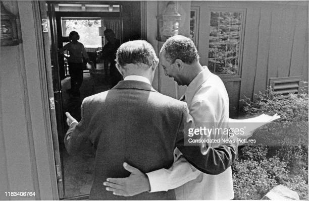 Arm in arm Egyptian President Anwar Al Sadat and Israeli Prime Minister Menachem Begin talk during the EgyptianIsraeli peace negotiations outside...