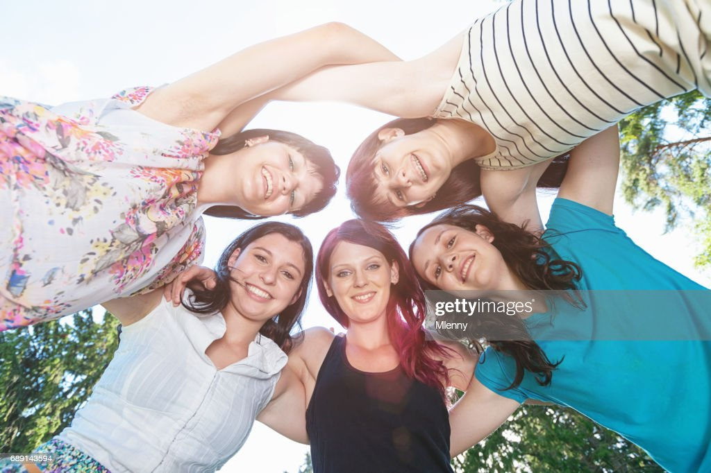 Arm in Arm Teenage Girls Together : Stock Photo