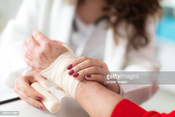 Arm injury treated with bandage