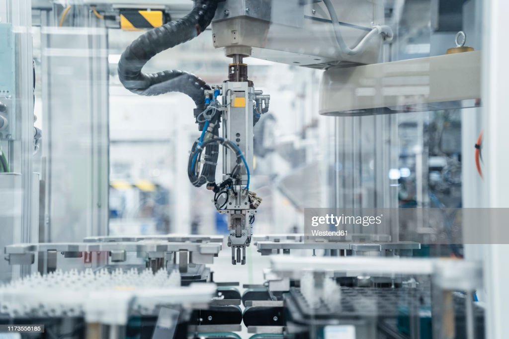 Arm of assembly robot functioning inside modern factory, Stuttgart, Germany : ストックフォト