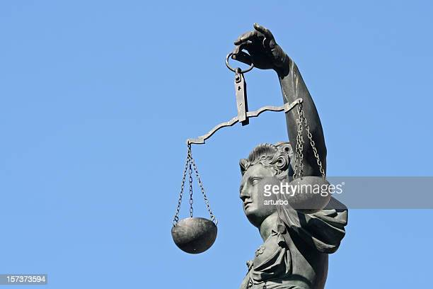 arm of Lady Justice in profile
