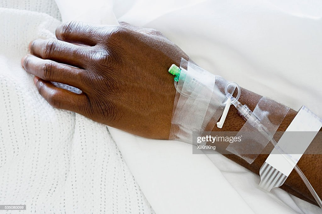 Arm of patient with drip : Stock Photo