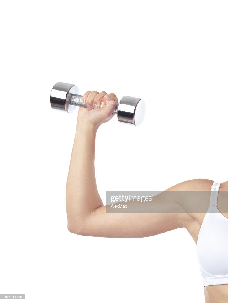 Arm of woman exercising with weight : Stockfoto