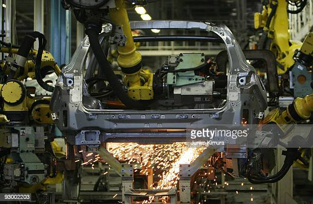 Arm robots assemble parts at Nissan's Tochigi Plant as Nissan announce the opening of the latest FUGA motor car production line on November 12 2009...