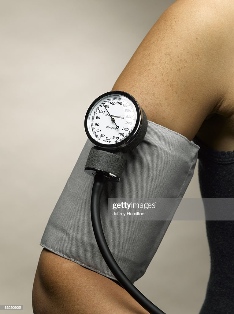 Arm with blood pressure cuff : Stock Photo