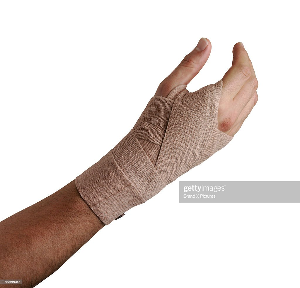 Arm with elastic cloth bandage : Stock Photo
