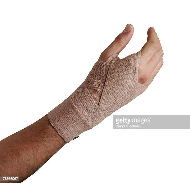 arm with elastic cloth bandage - elastic bandage stock photos and pictures