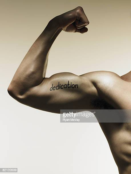 arm with word written on bicep