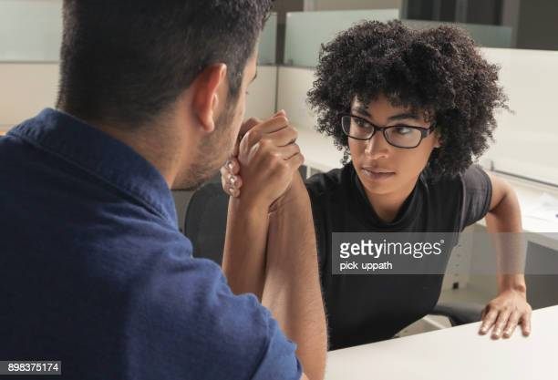 arm wrestle - gender stereotypes stock pictures, royalty-free photos & images