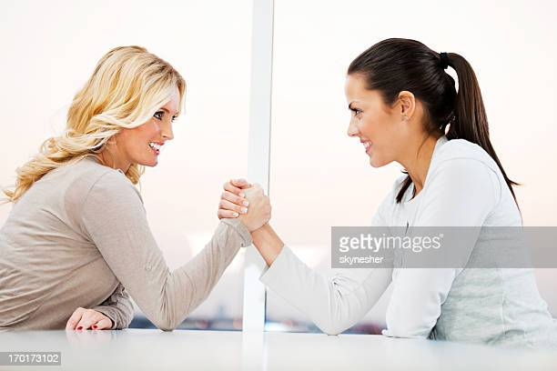 arm wrestling business - female wrestling stock photos and pictures