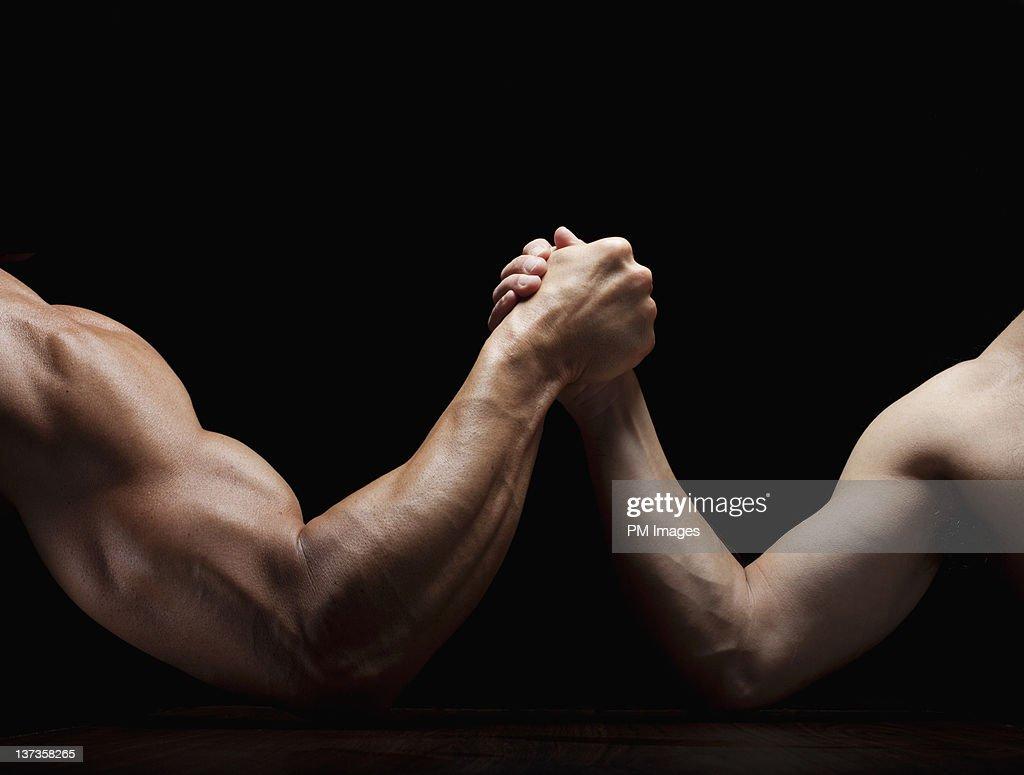 Arm Wrestling Mismatch : Stock Photo
