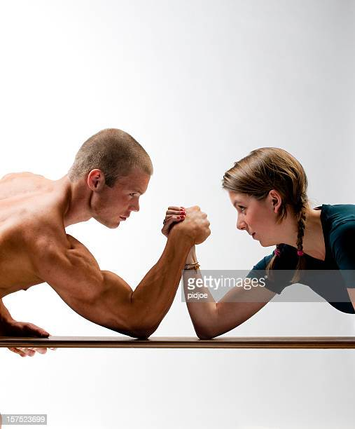 arm wrestling muscular build man and young woman