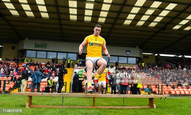 Armagh Ireland 25 May 2019 Declan Lynch of Antrim leads his team out for the team picture before the Ulster GAA Football Senior Championship...