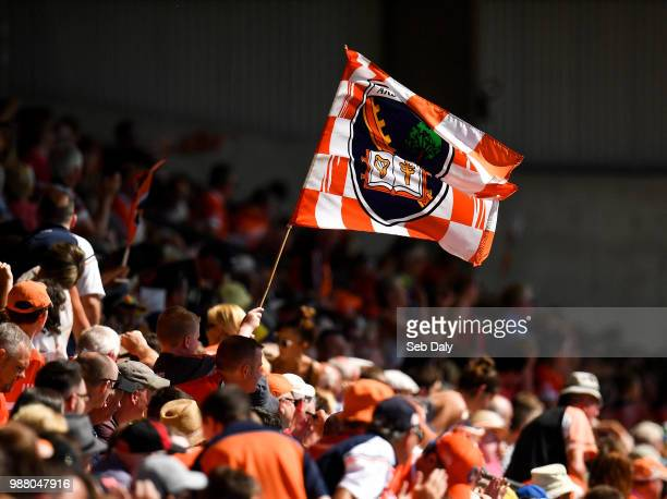 Armagh United Kingdom 30 June 2018 An Armagh supporter waves a flag during the GAA Football AllIreland Senior Championship Round 3 match between...