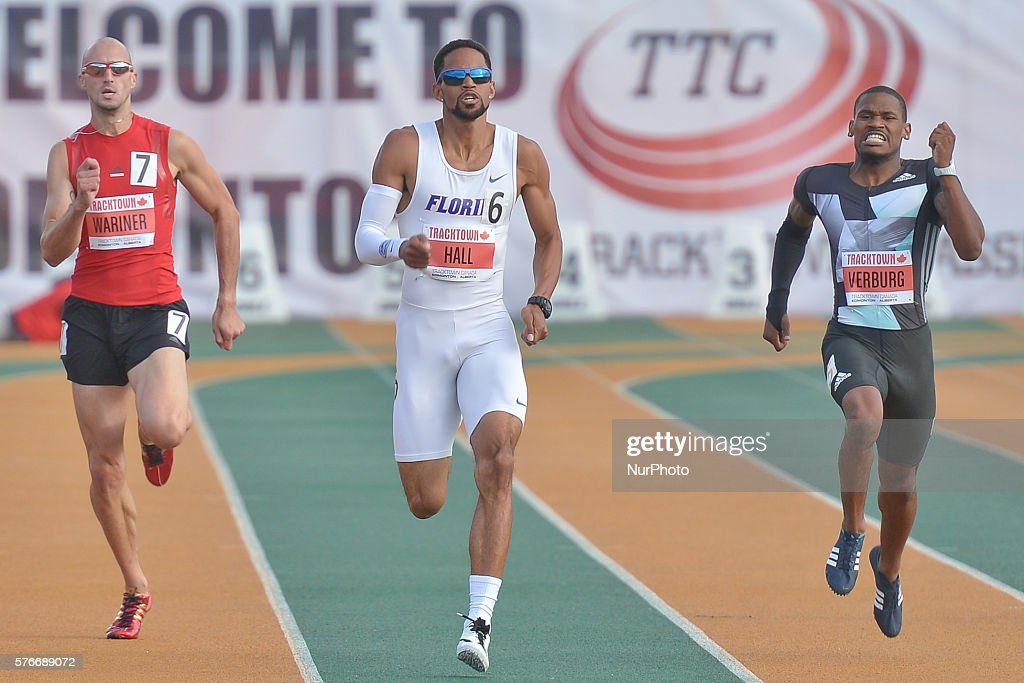 Arman Hall (Center) from USA on his way to win Men 400 M in 45.05 at Track Town Classic, at the University of Albertas Foote Field, in Edmonton. David Verburg (Right) finishes the second in 45.07 and Jeremy Wariner (Left) on the third place in 45.51. Edmonton's track & field meeting is currently ranked as a Top 30 meet in the World, Canadas premier one-day invitational/ international track & field competition, and the first major international meeting in North America after the Caribbean, Canadian and USA Championships and Olympic Selection Trials. On Friday, 15 July 2016, in Edmonton, Alberta, Canada.