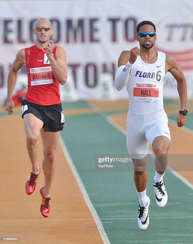 Arman Hall (Center) from USA on his way to win Men 400 M in 45.05 at Track Town Classic, at the University of Albertas Foote Field, in Edmonton. David Verburg (invisible) finishes the second in 45.07 and Jeremy Wariner (Left) on the third place in 45.51. Edmonton's track & field meeting is currently ranked as a Top 30 meet in the World, Canadas premier one-day invitational/ international track & field competition, and the first major international meeting in North America after the Caribbean, Canadian and USA Championships and Olympic Selection Trials. On Friday, 15 July 2016, in Edmonton, Alberta, Canada.