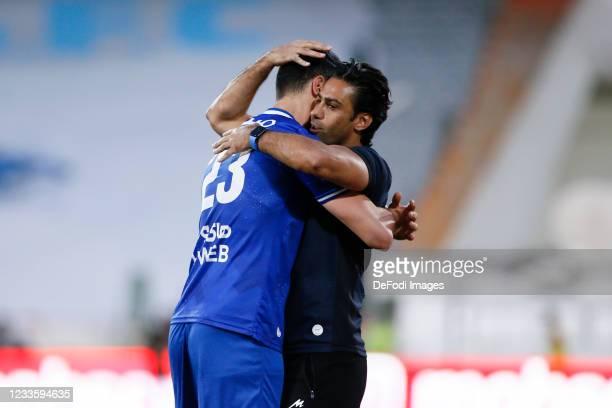 Arman Ramezani of Esteghlal, Head Coach Farhad Majidi of Esteghlal celebrates after scoring his teams first goal with Head Coach during the Persian...