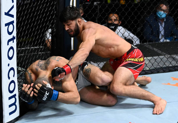 Arman Tsarukyan of Armenia punches Christos Giagos in a lightweight fight during the UFC Fight Night event at UFC APEX on September 18, 2021 in Las...
