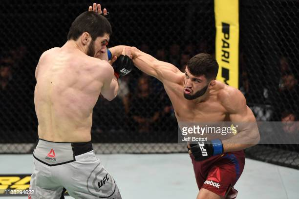 Arman Tsarukyan of Russia punches Islam Makhachev of Russia in their lightweight bout during the UFC Fight Night event at Yubileyny Sports Palace on...
