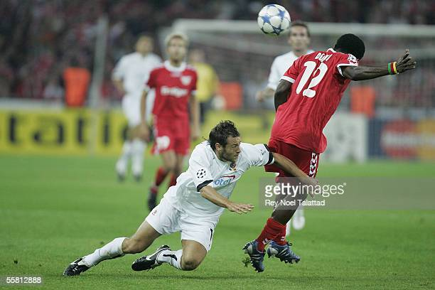 Armand Deumi of FC Thun holds off a challenge from Karol Kisel of Sparta Prague during the UEFA Champions League match between FC Thun and Sparta...
