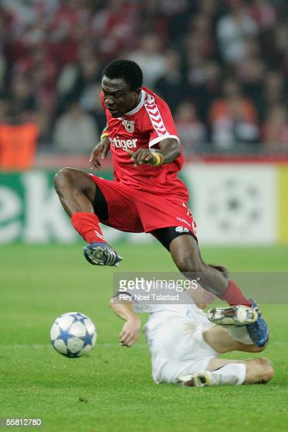 Armand Deumi of FC Thun jumps over Zdenek Pospech of Sparta Prague during the Champions League match between FC Thun and Sparta Prague at Stade de...