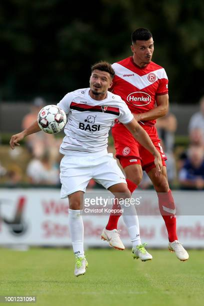 Armand Drevina of Wegberg and Alfredo Morales of Duesseldorf go up for a headerduring the Pre Season Friendly match between FC WegbergBeeck and...