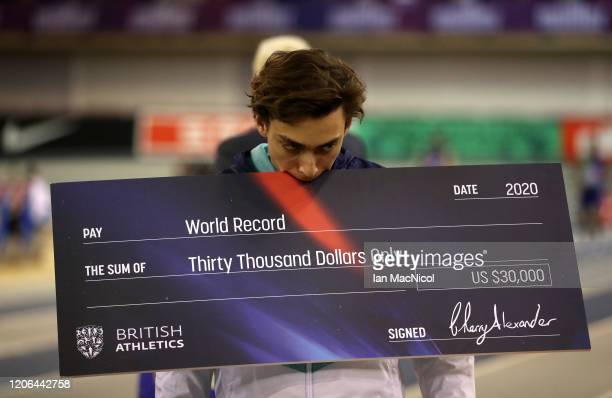 Armand Duplantis of Sweden celebrates winning and breaking the world record in the Men's Pole Vault Final during the Muller Indoor Grand Prix World...