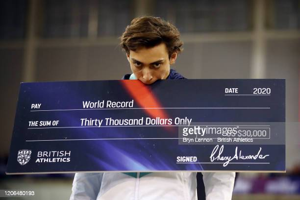 Armand Duplantis of Sweden poses with his prize money cheque after breaking the Pole Vault World Record during the Muller Indoor Grand Prix World...