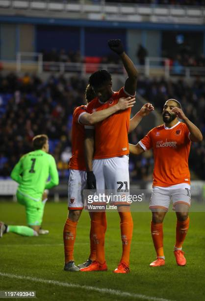 Armand Gnanduillet of Blackpool celebrates with teammates after scoring his team's second goal during the FA Cup Third Round match between Reading FC...