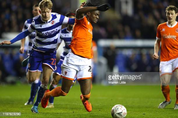 Armand Gnanduillet of Blackpool is awarded a penalty as he is brought down in the box by Teddy Howe of Reading FC during the FA Cup Third Round match...