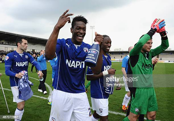 Armand Gnanduillet of Chesterfield celebrates their promotion during the Sky Bet League Two match between Burton Albion and Chesterfield at the...